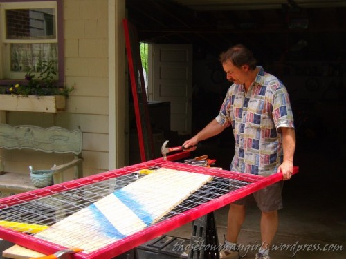 Burt making racks for art display