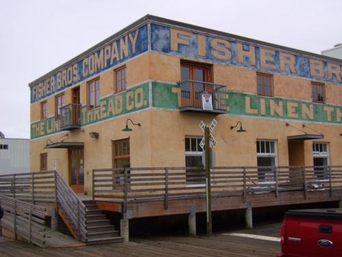 Old building by boardwalk near river